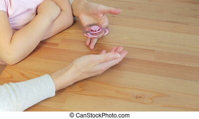 Woman with pink spinner