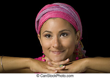 Woman with pink turban and pink earrings