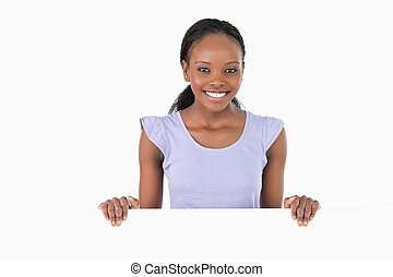 Woman with placeholder in her hands on white background