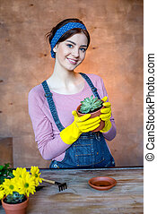woman with plant in flowerpot