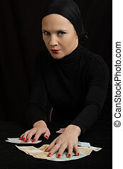 woman with playing cards and money