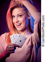 woman with poker cards gambling