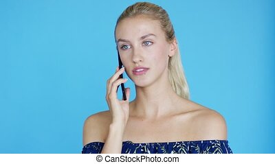 Woman with ponytail speaking on phone