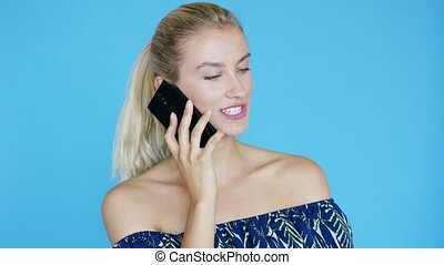 Woman with ponytail speaking on phone - Lovely young lady...