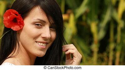 Woman with poppy flower