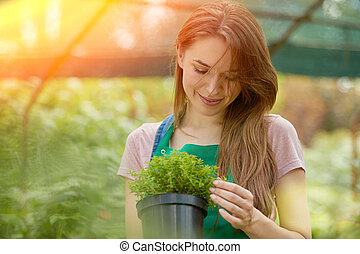 Woman with potted plant