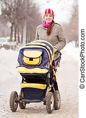 woman with pram in winte