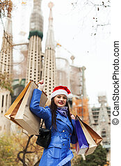 Woman with purchases in Barcelona