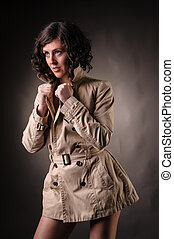 woman with raincoat fashion portrait