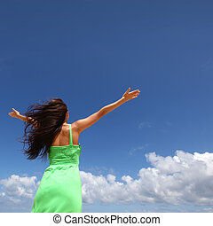 Woman with raised hands