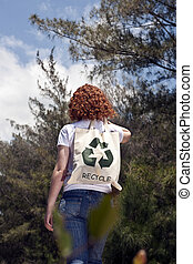 Woman with recycling bad in nature - Sustainable lifestyle:...
