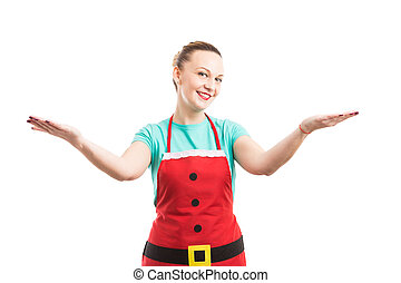 Woman with red apron making invitation and presentation gesture