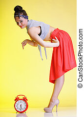 Woman with red clock. Time management concept. - Full length...