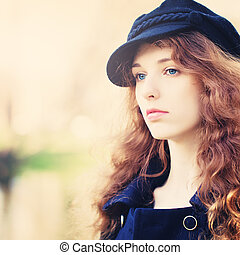 Woman with Red Curly Hair Outdoors
