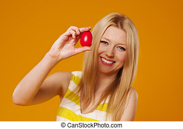 Woman with  red easter egg