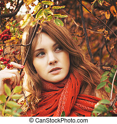 Woman with red hair and scarf outdoors