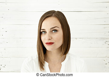Woman with red lips and intense gaze