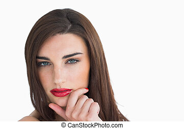 Woman with red lips holding her chin