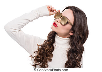 woman with red lips in gold sunglasses