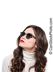 Woman with red lips in sunglasses