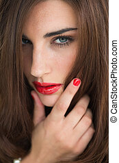 Woman with red lips looking thoughtful