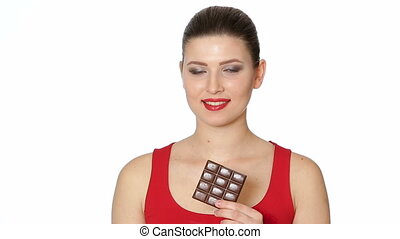 woman with red lipstick eats dark chocolate