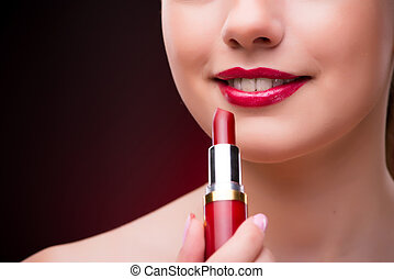 Woman with red lipstick in beauty concept