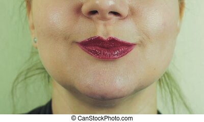 Woman with red pomade make funny face in front camera. Play...
