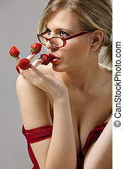 Woman with red strawberries picked on fingertips - Sexy...