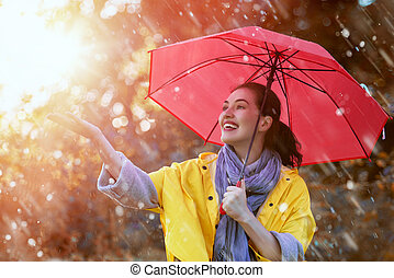 woman with red umbrella - Happy beautiful young woman with...