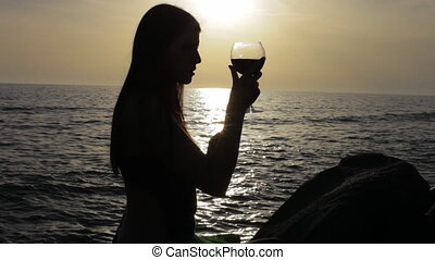 Woman with red wine silhouette