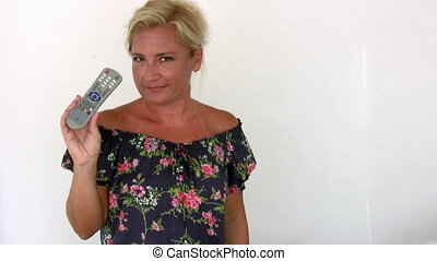 woman with remote control smiling