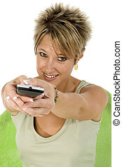 Woman aiming remote control with two hands.