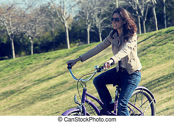 woman with retro bicycle