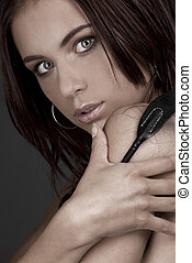 woman with riding crop - picture of beautiful woman with...