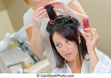 Woman with rollers in her hair