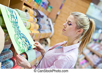 Woman with rolls of wallpaper - Young beautiful blond woman...