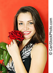 Woman with rose on a red