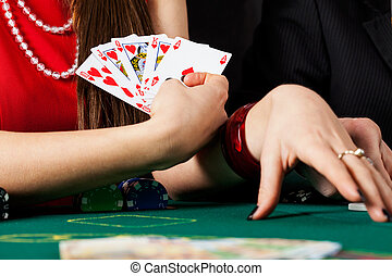 Woman with royal flush - A closeup of an elegant woman...