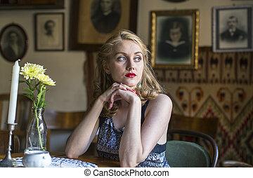 woman with sad eyes sitting
