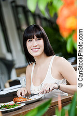 Woman with Salad - A young and attractive woman having a...