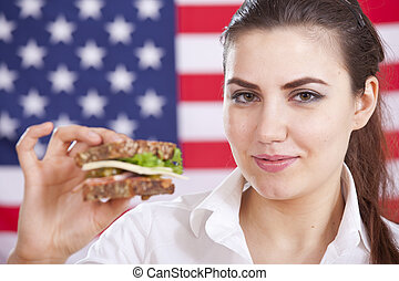 woman with sandwich over american flag