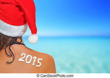 Woman with santas hat and 2015 written on her back