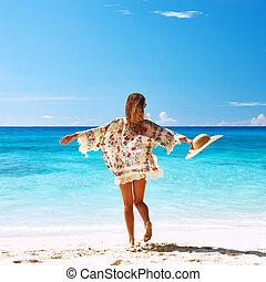Woman with sarong on beach at Seychelles - Woman with sarong...