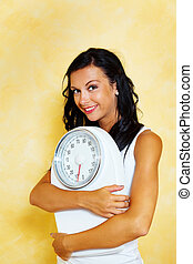 Woman with scales after a successful diet - A young woman...