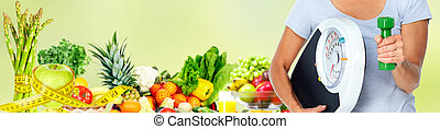 Woman with scales over green background. - Healthy woman...