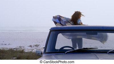 Woman with scarf having fun on the car 4k