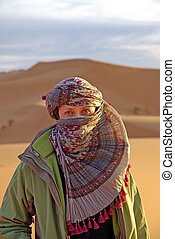 woman with scarf in the desert