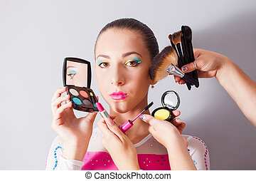 Woman with set of make-up
