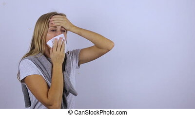 Woman with severe runny nose and cough